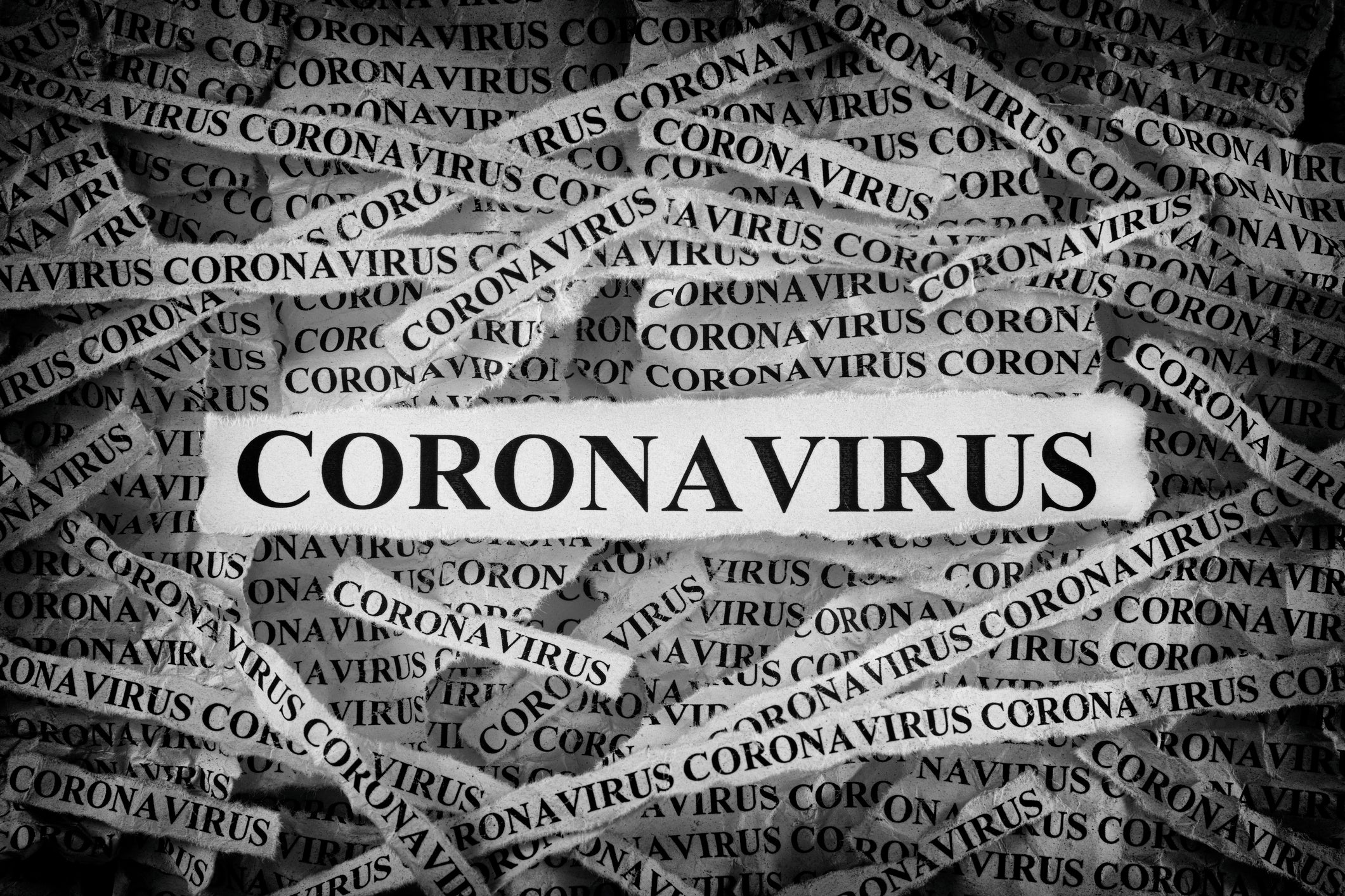 many strips of newsprint all reading coronavirus v2